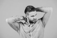 Macho in blue fashionable shirt, fashion. Man with bearded face and blond hair, haircut. Mens fashion style and trend. Grooming and hair care in beauty salon royalty free stock image