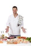 Macho caucasiano do cozinheiro chefe atrativo, refeições da diversidade foto de stock
