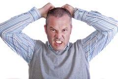 Macho caucasiano envelhecido médio frustrante louco irritado Imagens de Stock