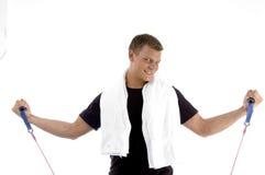 Macho feliz com exercício da corda Imagens de Stock Royalty Free