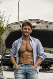 Macho handsome man leaning against his car Royalty Free Stock Images