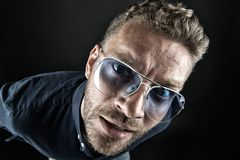 Free Macho In Glasses Look With Curious Face On Dark Background Stock Photo - 147431630