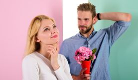 Macho likes to surprise woman. Bouquet flowers always pleasant gift idea. Girl waiting for date. Little surprise for her. Boyfriend bring bouquet flowers to stock photo