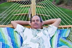 Macho maduro no Hammock Imagens de Stock Royalty Free