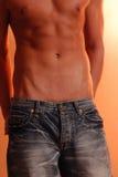 Macho magro nas calças de brim Imagem de Stock Royalty Free