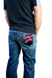 Macho man. A young man in jeans with a woman's panties in his pocket royalty free stock photos