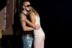 Macho Man Comforting His Girl Stock Photo