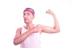 Macho nerd shows muscles Royalty Free Stock Photography
