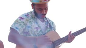 Macho plays the guitar. stock footage