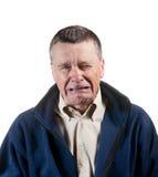 Macho sênior que sneezing imagem de stock royalty free
