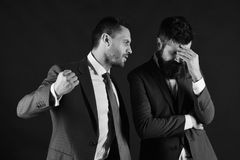 Machos in classic suits have business argument. Businessman with mad face ready to hit and punch opponent. Business rivalry concept. Men with beards argue on stock images