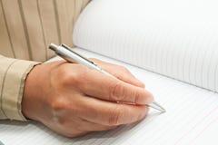Macht eine Anmerkung im Notizbuch Stockbild