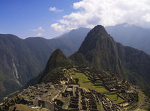 Machu Picchu. Wayna Picchu and surrounding mountains in the background Stock Images