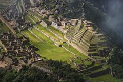 Machu Picchu aerial. Aerial view through scattered clouds to Machu Picchu ruins by early morning stock photos