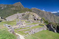 Machu Picchu, Aguas Calientes/Perú - circa junio de 2015: Ruinas de la ciudad perdida sagrada de Machu Picchu de incas en Perú fotografía de archivo libre de regalías