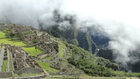 Machu Picchu, the ancient Inca city in the Andes, Peru. stock video footage