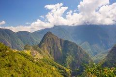 Machu Picchu archeological miejsce Picchu iluminujący światłem słonecznym i Wayna Zdjęcia Stock