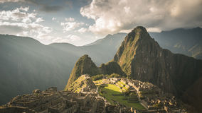 Machu Picchu archeological site, wide angle view from the terraces above with scenic sky. Toned image. Royalty Free Stock Photography