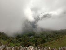 Machu Picchu bland molnen royaltyfria bilder