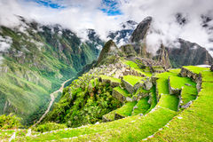 Machu Picchu, Cusco - Peru. Machu Picchu, Peru - Ruins of Inca Empire city and Huaynapicchu Mountain, Sacred Valley, Cusco. Amazing place of South America Royalty Free Stock Photo