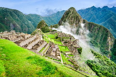Machu Picchu, Cusco, Peru. Machu Picchu, Peru - Ruins of Inca Empire city and Huaynapicchu Mountain, Sacred Valley, Cusco. Amazing place of South America Stock Images