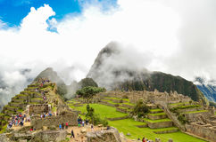 MACHU PICCHU, CUSCO REGION, PERU- JUNE 4, 2013: Panoramic view of the 15th-century Inca citadel Machu Picchu Royalty Free Stock Photo