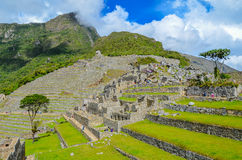 MACHU PICCHU, CUSCO REGION, PERU- JUNE 4, 2013: Panoramic view of the 15th-century Inca citadel Machu Picchu Royalty Free Stock Photography