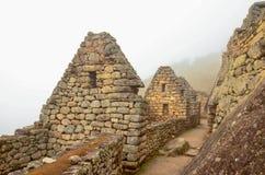 MACHU-PICCHU, CUSCO-REGION, PERU JUNI 4, 2013: Detaljer av bostadsområdet av för århundradeInca för th 15 citadellen Machu Picchu Royaltyfri Bild