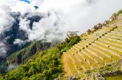 MACHU-PICCHU, CUSCO-REGION, PERU JUNI 4, 2013: Detaljer av bostadsområdet av för århundradeInca för th 15 citadellen Machu Picchu Fotografering för Bildbyråer