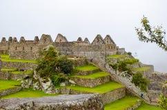 MACHU-PICCHU, CUSCO-REGION, PERU JUNI 4, 2013: Detaljer av bostadsområdet av för århundradeInca för th 15 citadellen Machu Picchu Royaltyfria Bilder