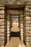 Machu Picchu Doorway. View through a doorway at the Incan ruins of Machu Picchu royalty free stock image