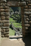 Machu Picchu doorway. A doorway in the ancient Inca site Machu Picchu with in the background the typical Inca buildings Stock Photo