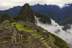 Machu Picchu in fog Royalty Free Stock Photos