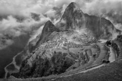 Machu picchu in fog. The picture shows a view in machu picchu in the flog. The lost city is in the fog, while the rive at the bottom is visible peru ancient royalty free stock photography