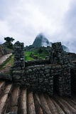 Machu Picchu. Foggy morning at Machu Picchu Royalty Free Stock Photos