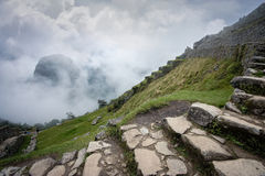 Machu Picchu. Foggy morning at Machu Picchu stock photos