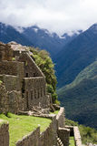 Machu Picchu grass roof stone bldg Stock Images