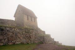 Machu Picchu Guardhouse. Under dense fog (Peru stock photo