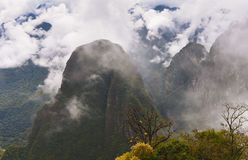 Machu Picchu Inca Ruins in the cloud. Cloud surrounds the peaks of Machu Picchu.  The 10th Century Inca ruins of a cultural and religious site sit on top of Stock Photography