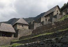 Machu Picchu, maisons des dispositifs protecteurs Photo stock