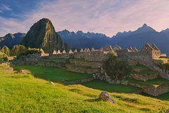 Machu Picchu in morning pink light royalty free stock photography