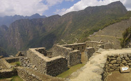 Machu Picchu mountain and ruins. Machu Picchu inca house ruins. Machu Picchu entrance and Mountain in background Stock Photography