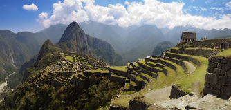 Machu Picchu panorama. Panoramana of Machu Picchu, Guard house, agriculture terraces, Wayna Picchu and surrounding mountains in the background Stock Photo