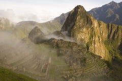 Machu Picchu, Peru. The ruins of Machu Picchu, Peru in an early morning fog stock photography