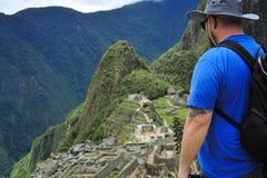 Machu Picchu In Peru Man. Machu Picchu in Peru view of men looking down upon it Royalty Free Stock Images