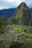 Machu Picchu In Peru Man. Machu Picchu in Peru view of men looking down upon it Royalty Free Stock Photos