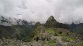 Machu Picchu, Peru Travel, South America. Tourists can be seen in the distance at Machu Picchu is Peru. South America is a popular travel destination for people stock footage