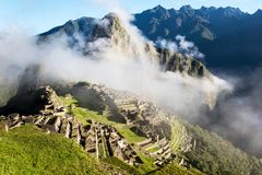 Machu Picchu Peru with clouds. View of the city of Machu Picchu Peru, view from the mountain royalty free stock photo