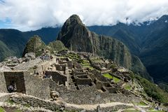Machu Picchu Peru, residential section. View of the city of Machu Picchu Peru, residential section, with clouds stock photography