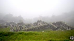 Machu Picchu ruins. Ancient ruins of Machu Picchu in deep fog, panoramic footage stock video